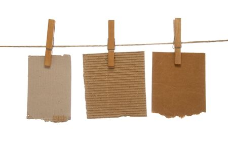 close up of postit reminders and clothespins attached to a rope on white background Stock Photo - 4603395