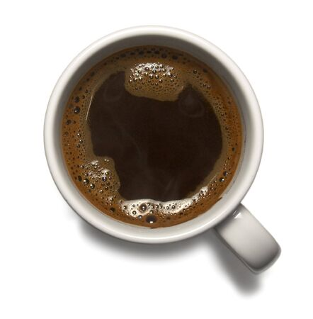 close up of cup of coffee on white background