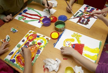 kids painting: little children painting during art class