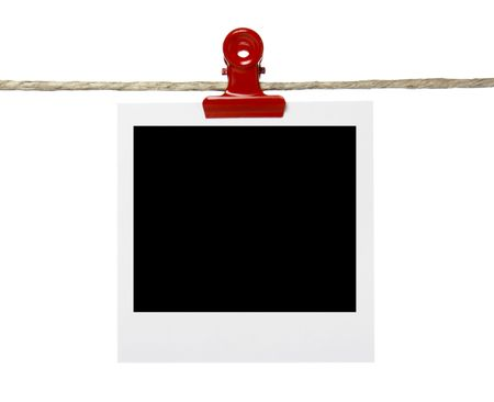 close up of instant film transfer photo on a clothesline on white background Stock Photo - 4614017