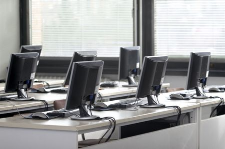 training device: interior of classroom with computers Stock Photo