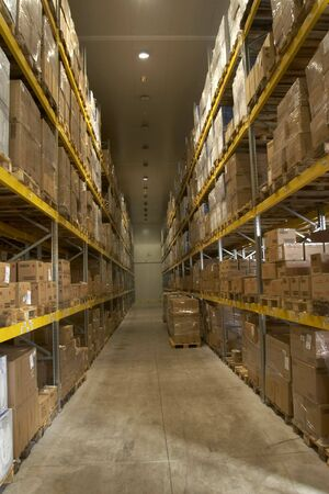 interior of storage of boxes stack and forktruck in a factory Stock Photo - 4656023