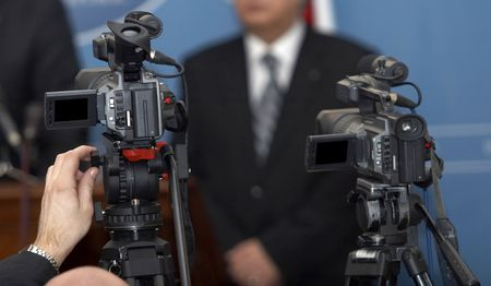 close up of conference meeting and broadcasting camera photo