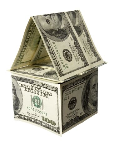 cardboard house: close up of miniature house  built of paper currency on white background Stock Photo
