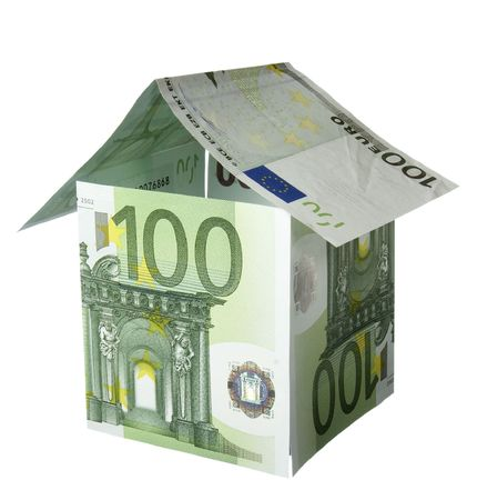 valuta: close up of miniature house  built of paper currency on white background Stock Photo