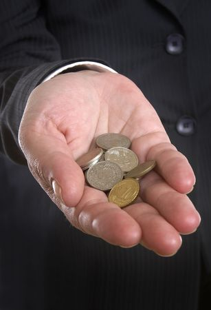 close up of businesswoman hand and coins Stock Photo - 4728113