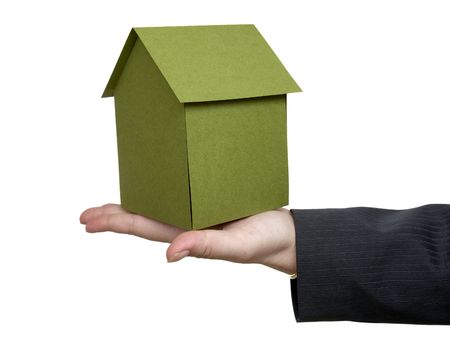 close up of businesswoman and miniature house on white background  photo