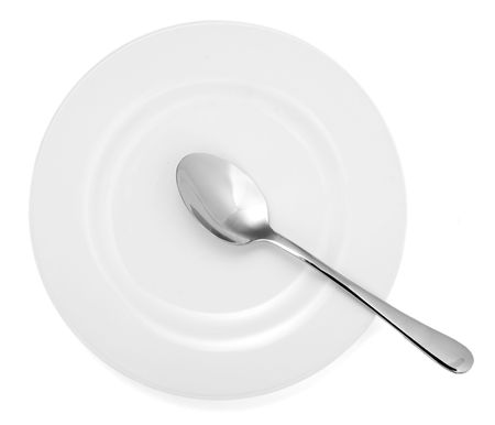 close up of spoon and plate on white background  Stock Photo - 4728078