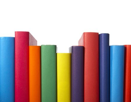 the topics: close up of stack of colorful books on white background