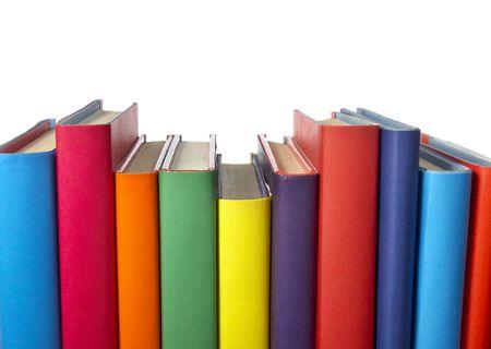 pile of books: stretta di pila di libri colorato su sfondo bianco Archivio Fotografico