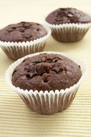 ailment: still life of chocolate muffins on kitchen table