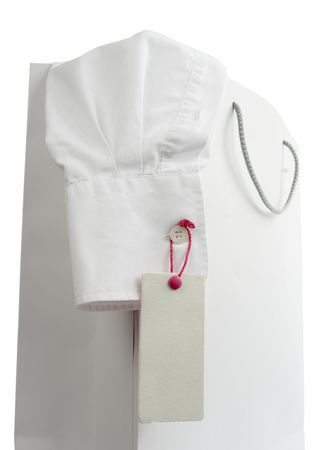 neat: close up of shopping bag and shirt with price label