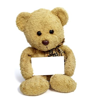 close up of teddy bear holding blank note card on white background