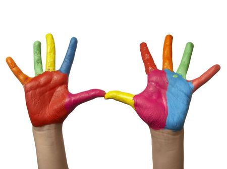 reach: close up of child hands painted with watercolors, on white background with clipping Stock Photo