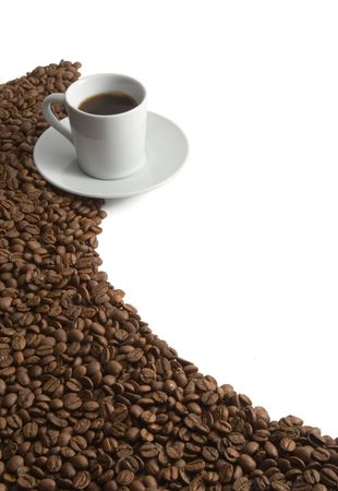 coffee harvest: close up of coffee beans and coffee cup on white background
