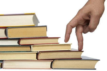 heaped: close up of stack of books on white background, with clipping included Stock Photo