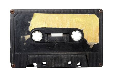 medium closeup: close up of audio tape cassette on white background with path