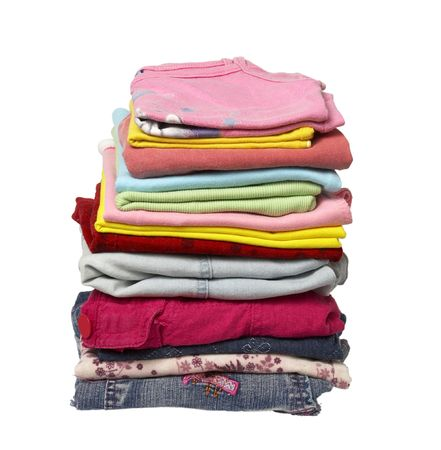 hang up: close up of stack of shirts and other clothes on white background with clipping Stock Photo