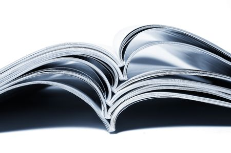 close up of stack of magazines on white background photo
