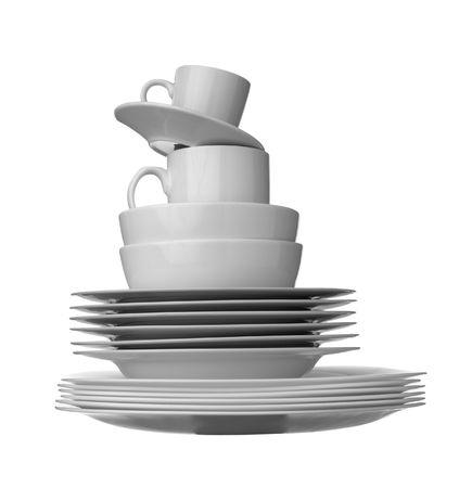 plate setting: close up of stack of white ceramic dishes on white background