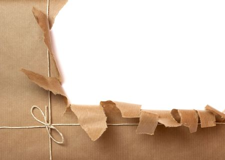send parcel: close up of package ripped on white background  Stock Photo