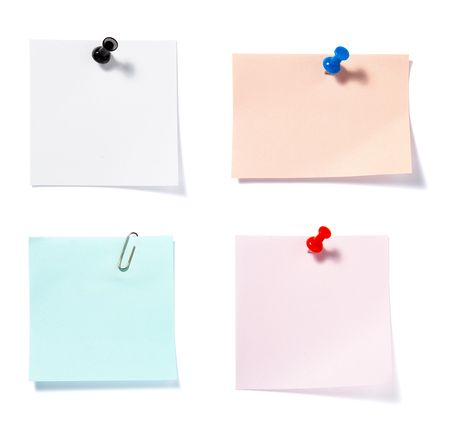 drawing pins: close up of postit reminders on white background . each one is in cameras full resolution