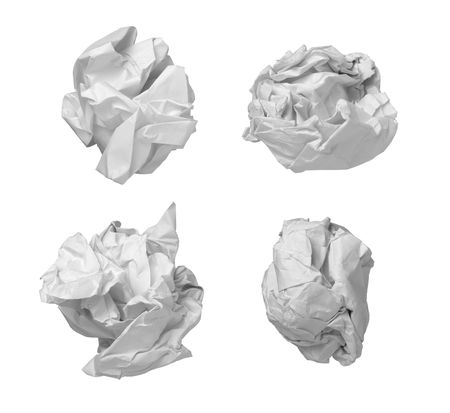 useless: collection of various balls of paper on white background. each one is in camers full resolution