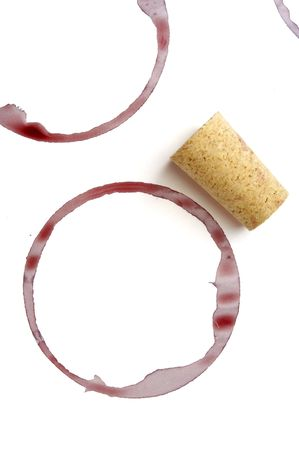close up of red wine marks and cork on white background Stock Photo - 5281458
