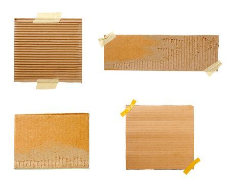collection of pieces of cardboard on white background. each one is in full cameras resolution photo