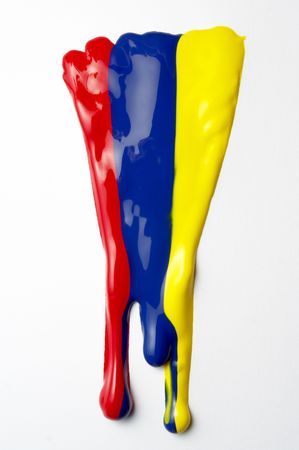 close up of colorful paints leaking down on white background Stock Photo - 5336554