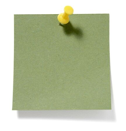 drawing pins: close up of postit reminders on white background
