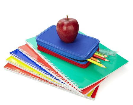 food supply: close up of school supplies in pencil case  on white background