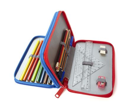 case: close up of school supplies in pencil case  on white background