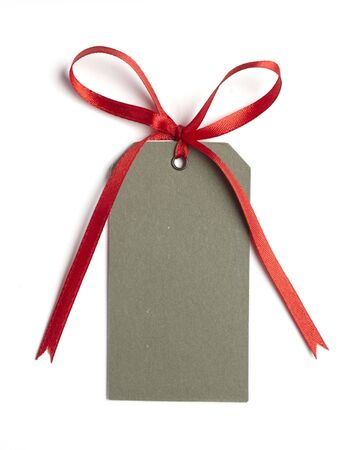 close up of card note with  red ribbon on white background on white background with clipping path Stock Photo - 5664936