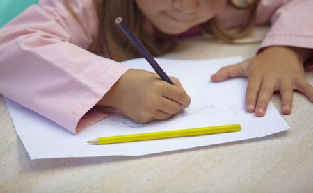 kids writing: little children painting during art class