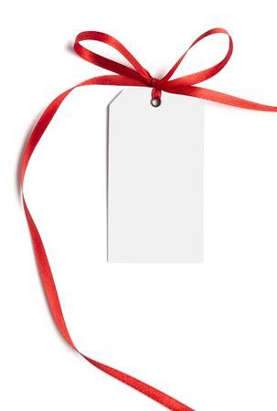 close up of white card note with  red ribbon on white background on white background with clipping path photo