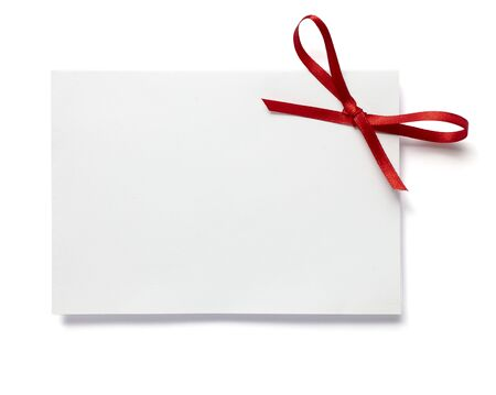 note card: close up of white card note with  red ribbon on white background on white background with clipping path