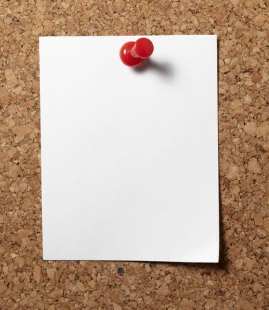 push pins: note paper with push pins on cork board