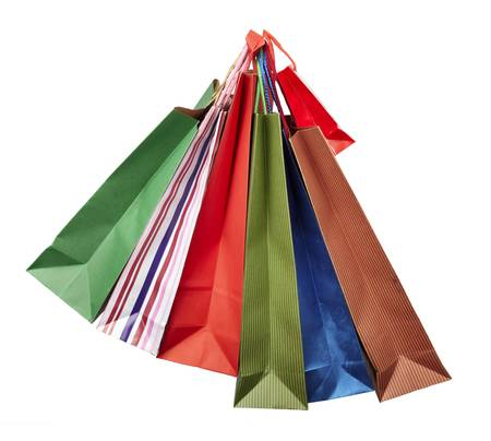 collection of shopping bags hanging on white background with clipping path photo