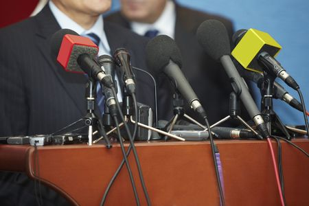 public speaking: close up of conference meeting microphones