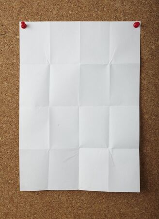 note paper with push pins on cork board photo
