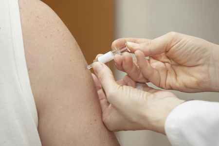 close up vaccine injection and arms in hospital photo