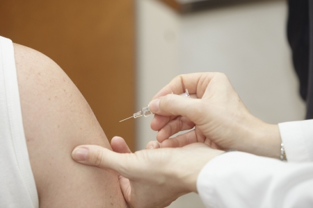 close up vaccine injection and arms in hospital Stock Photo - 6003279