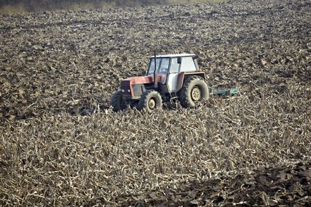 tractor working on cultivated land cultivation Stock Photo - 6073892