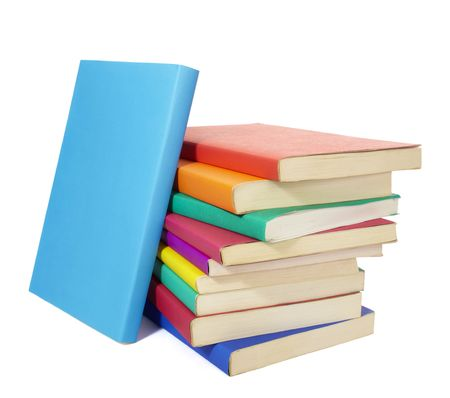 close up of stack of colorful books on white background, with clipping path included photo
