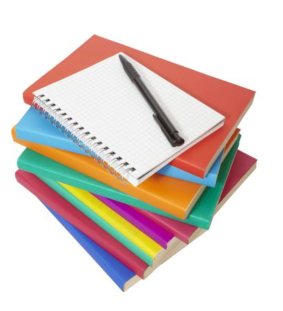 close up of stack of colorful books and notebook on white background, with clipping path included photo