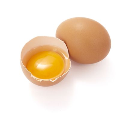 halved: close up of halved broken egg on white background, with clipping path