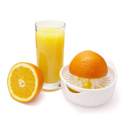 close up of fresh orange juice preparation, on white background   photo