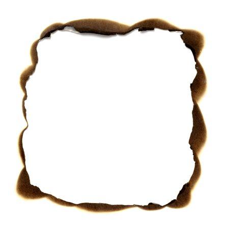 burned: close up of burnt paper hole on white background