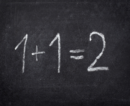 closeup of chalkboard and simple math addition  photo